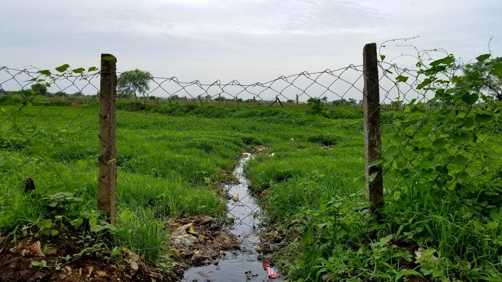 Donde Khurd water flowing into field
